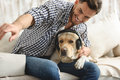 Labrador Listening To Music While Its Owner Playing With Him Stock Photography - 78945712
