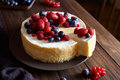 Homemade Christmas Winter Berry Fruit Cheesecake On Wooden Dark Table. Creamy Mascarpone Dessert. Stock Photo - 78974340
