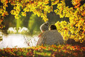 Two Children, Boys, Sitting On The Edge Of A Lake On A Sunny Autumn Royalty Free Stock Photo - 78978365