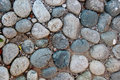 Closeup Of An Old Pebblestone Road Cobbled With Natural Stones Stock Photos - 78994913