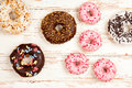 Tasty Donuts On White Wood Background Stock Images - 78997324
