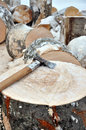 Axe On A Chunk Of Firewood In The Snow Royalty Free Stock Images - 79037109