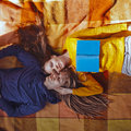 Pretty Young Couple Lying On On The Plaid, Autumn, Hugging Time, Royalty Free Stock Image - 79038406