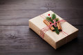 Gift Or Present Box Wrapped In Kraft Paper With Christmas Decoration On Vintage Wooden Table. Copy Space For Text. Stock Photo - 79042940