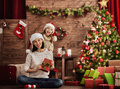 Mother And Daughter Exchanging Gifts Stock Image - 79045841