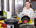 Girl Looking For New Pan And Pot In Supermarket Stock Photography - 79046442