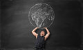 The Earth Pictured On Blackboard And Sporty Man Acting Like He Is Holding It Up Above Himself Stock Images - 79063724