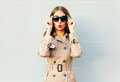 Fashion Elegant Pretty Young Woman Blowing Red Lips Wearing A Black Sunglasses Coat Over Grey Stock Photo - 79064150