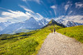 Young Couple Hiking In Panorama Trail Leading To Kleine Scheideg Royalty Free Stock Image - 79068806
