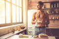 Sexy Young Man In Kitchen Stock Image - 79073551