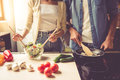 Young Couple In Kitchen Royalty Free Stock Image - 79073616