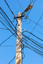 Electric Power Post With Wire Against Blue Sky Stock Image - 79097411