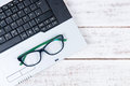 Top View Of Laptop And Glasses A On The Accountant White Table.B Stock Image - 79113141