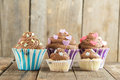 Vanilla Cupcake With Chocolate Topping. Old Wooden Background. Stock Photos - 79237703