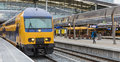 Train Passing By Near Platform Stock Images - 79247204