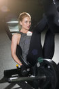 Sportive Woman Using Weights Press Machine For Legs. Gym. Stock Photo - 79249480