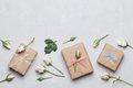 Gift Or Present Box Wrapped In Kraft Paper And Rose Flower On Gray Table Top View. Flat Lay Styling. Copy Space For Text. Stock Images - 79253854