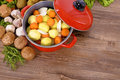 Red Casserole Dish With Winter Vegetables And Herbs Royalty Free Stock Photos - 79274338