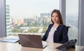 Young Asian Business Woman In Suit Working On Laptop Stock Photos - 79278803