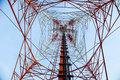 Red White Telecommunication Tower Against Blue Sky - Bottom View Royalty Free Stock Photo - 79286915