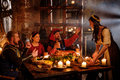 Medieval People Eat And Drink In Ancient Castle Kitchen Interior Royalty Free Stock Photography - 79308277