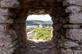 Old Windmill Through Small Window In Fortress Wall, Obidos Royalty Free Stock Images - 79310069