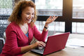 Smiling Ginger Woman Talking Per Skype Royalty Free Stock Photography - 79313067