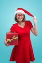 Mrs. Santa. Beautiful Young Asian Woman In Santa`s Hat Holding A Royalty Free Stock Images - 79364919