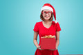 Mrs. Santa. Beautiful Young Asian Woman In Santa`s Hat Holding A Royalty Free Stock Image - 79364936