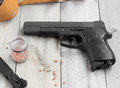 Air Gun, Holder, Holster And Balls For Firing On A Wooden Table. Royalty Free Stock Image - 79481416