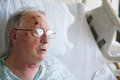 Old Man Sleeping In Hospital Bed After Falling And Injuring Hims Stock Images - 79494124