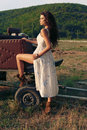 Beautiful Woman With Dark Hair  In Casual Clothes, Posing On Farm Royalty Free Stock Images - 79494219