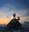 Two Of Asian Business Man Helping Hand To Climbing Up To Peak Of Stock Image - 79533681