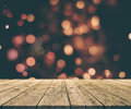 Christmas Background With Old Wooden Table Against Bokeh Lights Stock Photos - 79535763