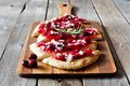 Flatbread Appetizer With Cranberry Sauce And Cheese, On Serving Board Royalty Free Stock Images - 79566059