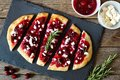 Holiday Flatbread Appetizer With Cranberries And Goat Cheese, Overhead Scene Stock Image - 79567521