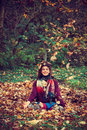 Young Woman In Yoga Position In Autumn Leaves Royalty Free Stock Photo - 79568965