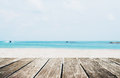 The Beach In Summer, Wooden Terrace With Defocused Tropical Beach Stock Photo - 79574580