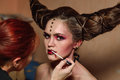 Stylist Makes Halloween Makeup, Brushing Blood On Models Lips Stock Photography - 79588212