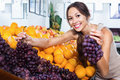 Female Customer Holding Ripe Bunch Of Grapes Stock Image - 79590941