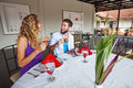 Waitress Serving Caucasian Couple In Restaurant In Bali Royalty Free Stock Photo - 79599335