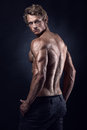 Strong Athletic Man Fitness Model Posing Back Muscles Stock Photo - 79600830
