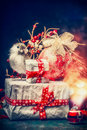 Lovely Christmas Card With Beautifully Packed Gifts, Holiday Balls , Bird And Festive Bokeh Lighting. Royalty Free Stock Image - 79664076