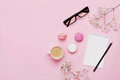 Coffee, Cake Macaron, Notebook, Eyeglasses And Flower On Pink Table From Above. Female Working Desk. Cozy Breakfast. Flat Lay. Royalty Free Stock Photo - 79676325