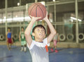Boy Preparing For Basketball Shooting At Sports Field Royalty Free Stock Photo - 79709835