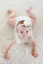 Cute Baby On The White Carpet Royalty Free Stock Photography - 79736607