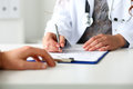 Female Doctor Hand Hold Silver Pen Filling Patient History List Royalty Free Stock Photography - 79775607