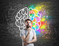 Man With Beard Standing Near Brain Sketch Stock Photo - 79793560