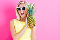 Happy Young Woman Holding A Pineapple Stock Image - 79808241