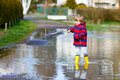 Little Kid Boy Playing With Fishing Rod By Puddle Stock Photos - 79846953